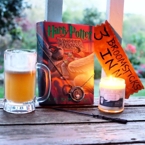 Harry Potter book, candle and butterbeer.