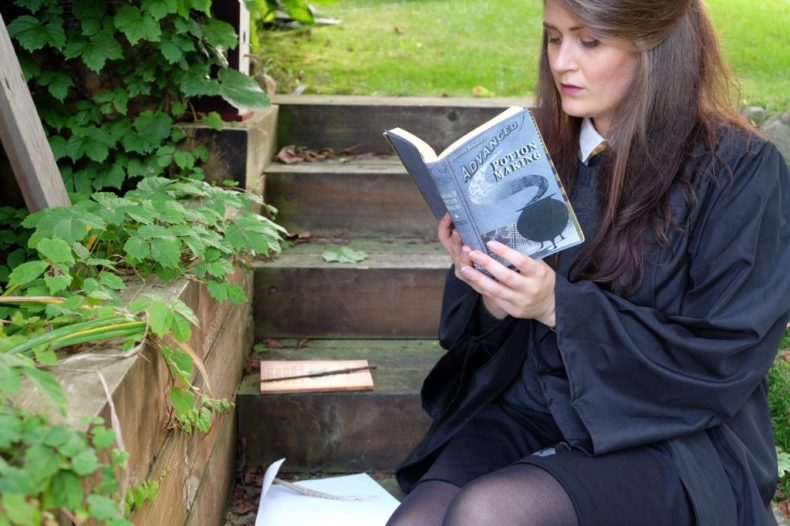 Reading the potions textbook in my Hogwarts uniform
