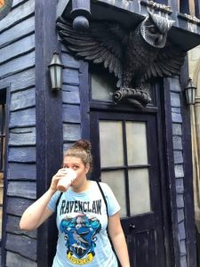 Anna drinking butterbeer at the Owl Post