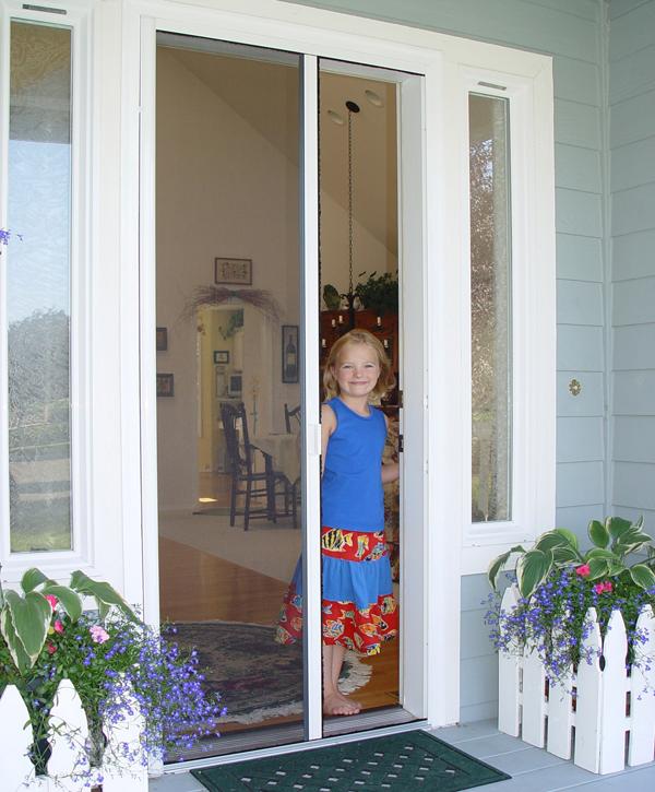 Casper Single Door Retractable Screen In White Frame On Front Door.