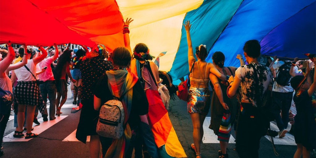 Header image showing Pride march