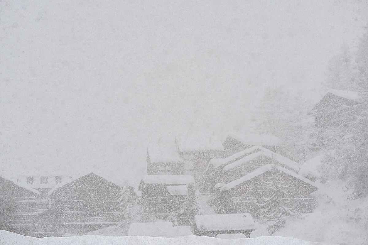 rural snowy village during severe blizzard