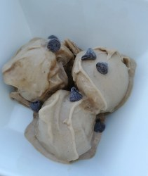 close up peanut butter chocolate nice cream topped with chocolate chips