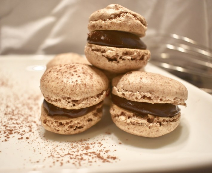 Side view of nut free macarons with sea salt chocolate ganache