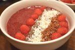 Closeup of Vegan Smoothie Bowl with fresh raspberries