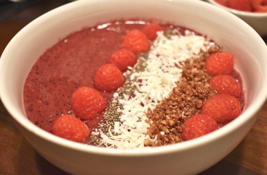 Closeup of Vegan Smoothie Bowl with fresh raspberries