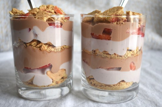 Side shot of vegan chocolate strawberry trifles to show off layers