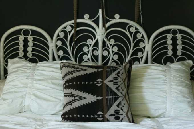 vintage white peacock headboard with crane and canopy bedding