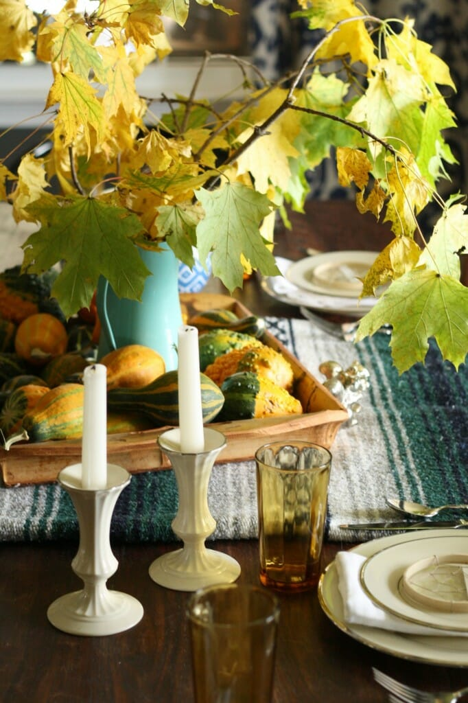 bohemian thanksgiving table with natural touches, vintage finds, mexican blanket