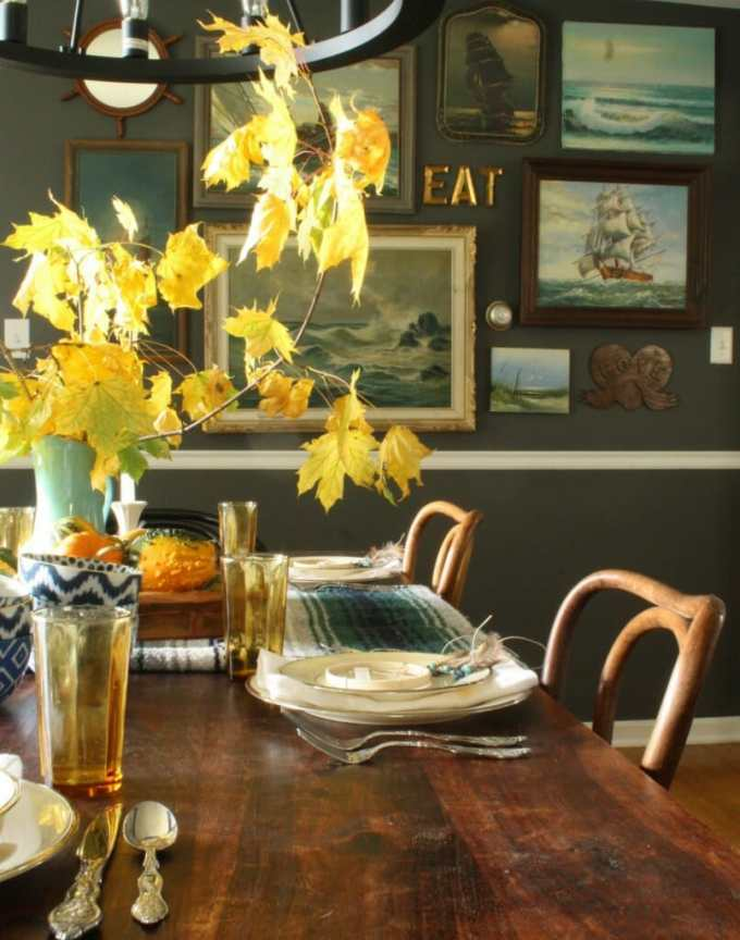 moody dining room with bohemian table, natural touches