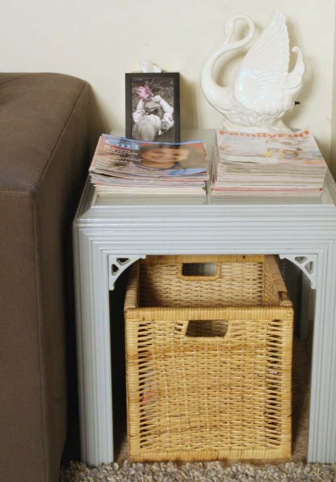 playroom end table with stacked magazines