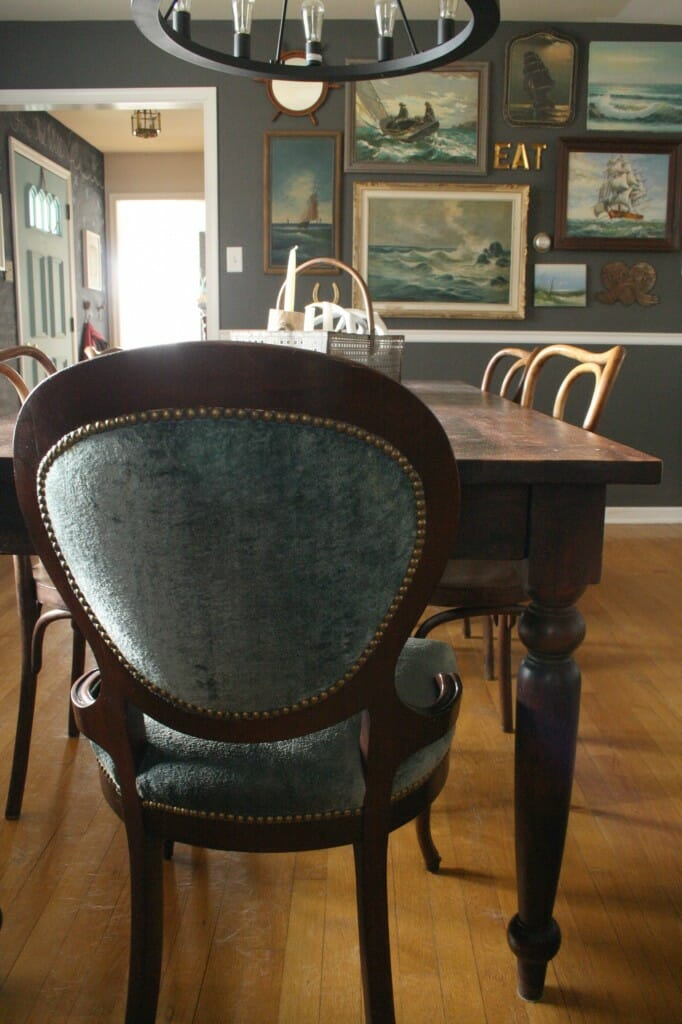 dusty blue velvet chairs in dining room/ awesome vintage nautical gallery wall
