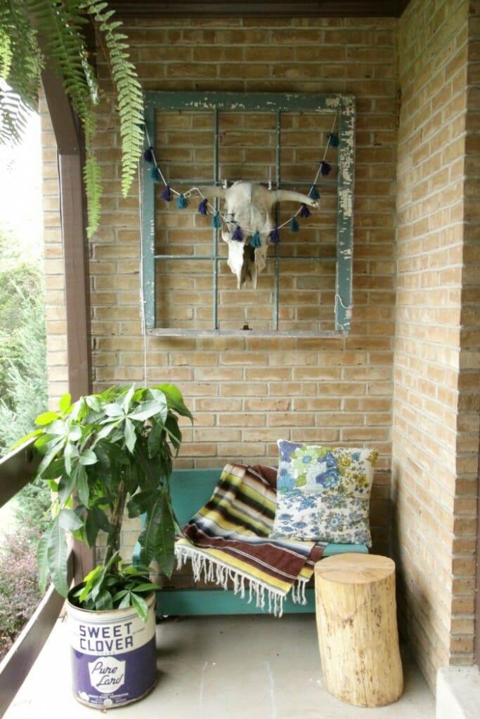 Fall Porch Entry- mexican blanket, bull skill, tassel garland, stump table
