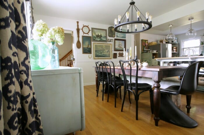 Eclectic Dining Room with Nautical Gallery Wall