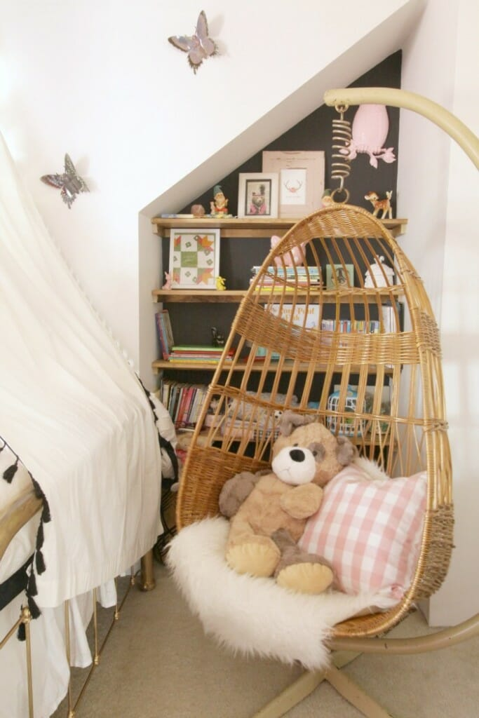 Hanging Chair and book nook in girl's room
