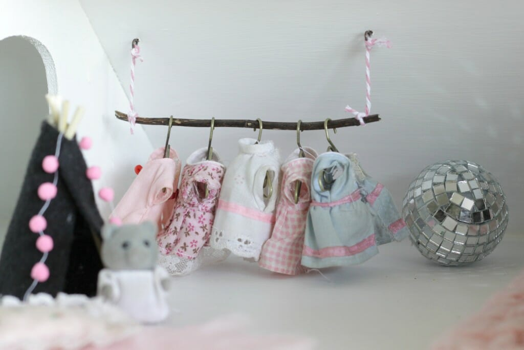 Branch as dollhouse clothing rack