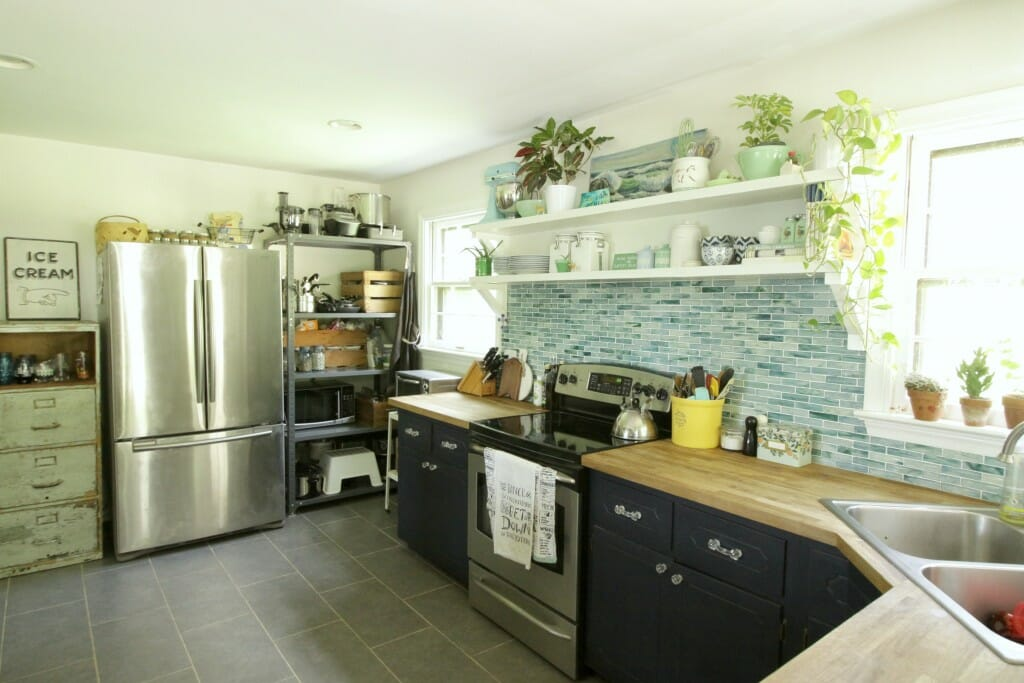 Eclectic Kitchen with Navy Cabinets and aqua recycled glass backsplash