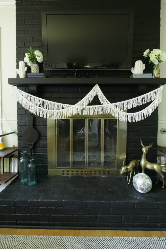 Black Fireplace and Modern Boho Mantle with Fringe, Cacti, white peonies