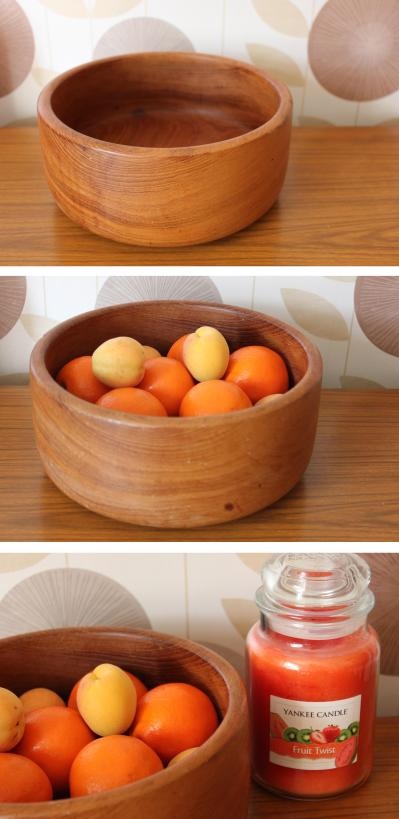 cassiefairys retro midcentury living room design - wooden fruit bowl with autumn oranges and yankee candle