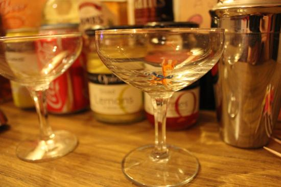 cocktail making with retro babycham champagne glasses