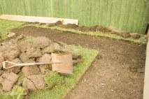 DIY digging out a garden path_
