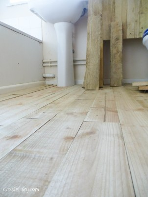 using recycled wood from a skip to make a beach hut bathroom floor and storage-4