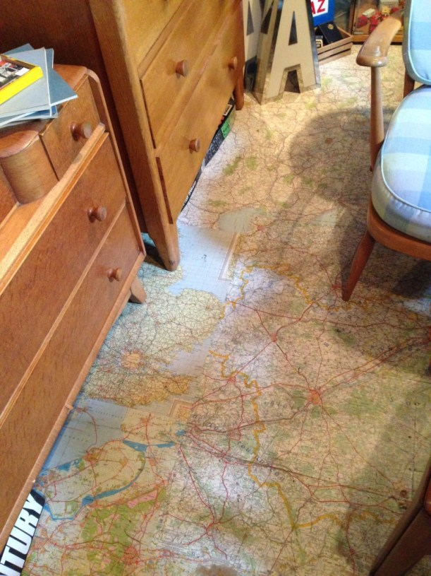 Vintage maps used as flooring