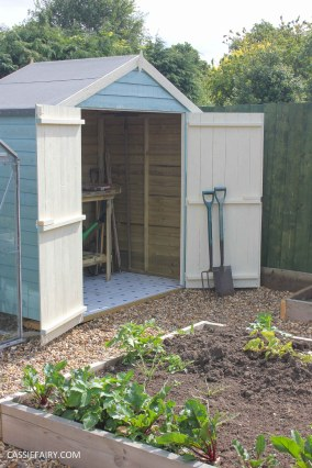 diy painting and installing small shed - duck egg blue beach hut in garden-25
