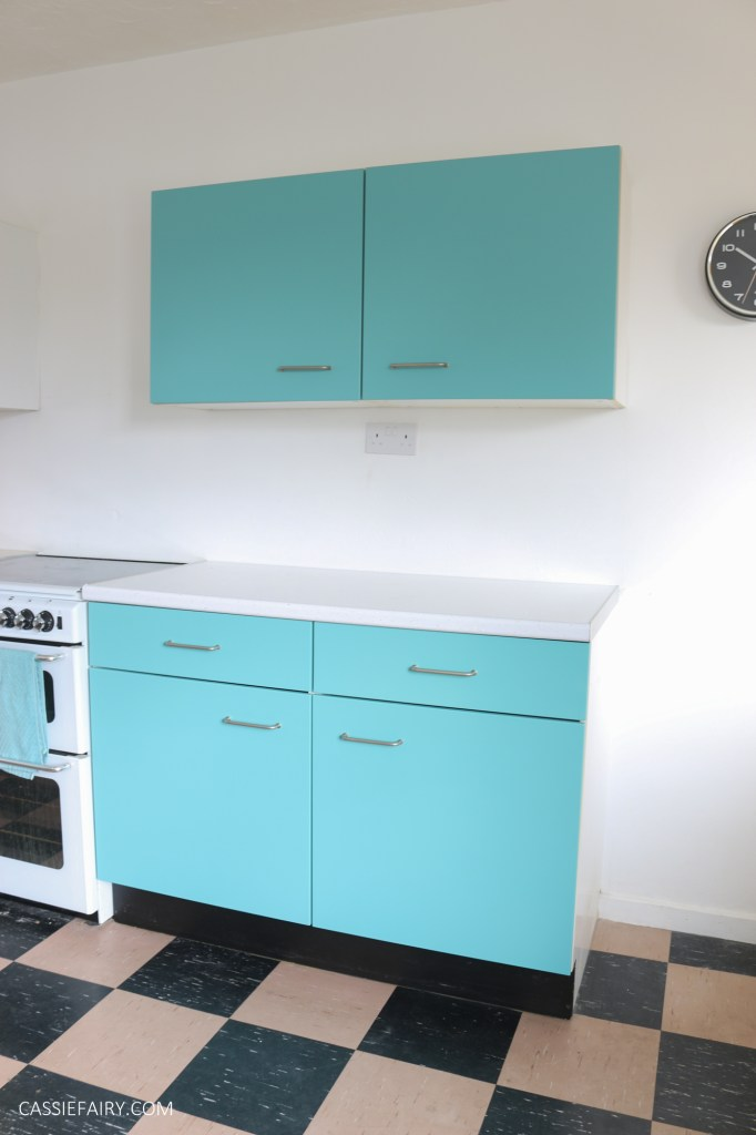 Kitchen cabinets painted in turquoise blue with vintage style white oven