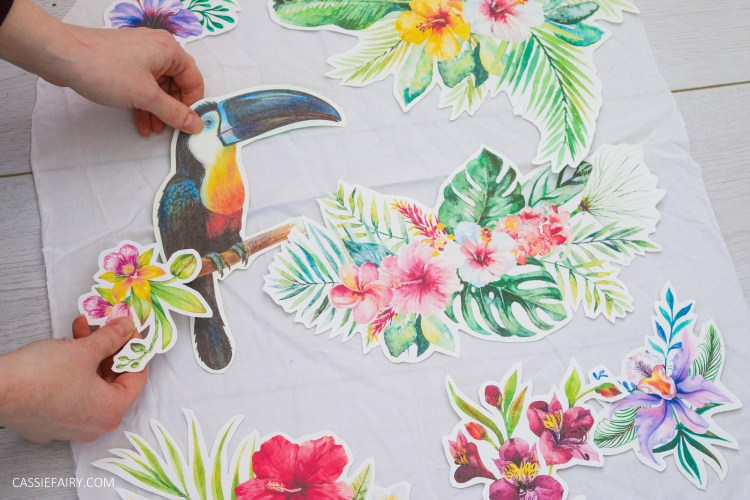 Photo of tropical iron-on transfer designs being positioned onto fabric.