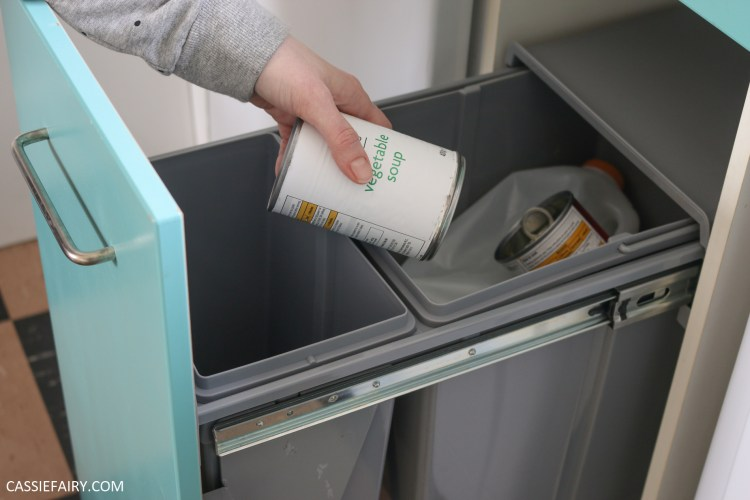 Photo of a tin being put into a recycling bin