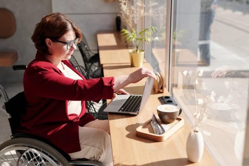 photo of woman using laptop
