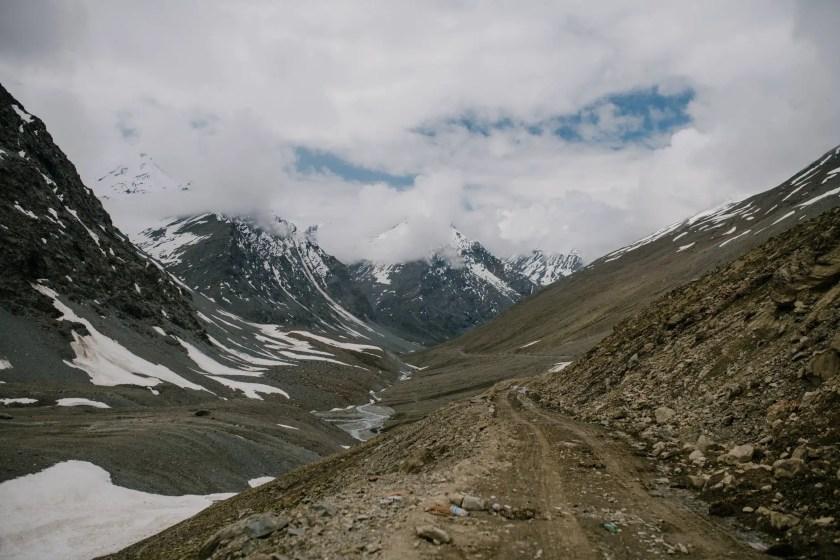 cloudy sky over snowy mountain range