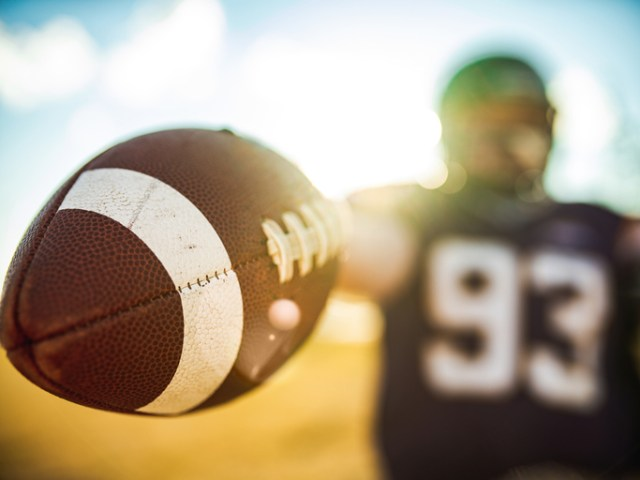 Football in the hands during game