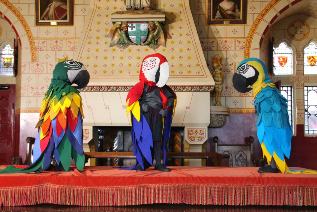 Three sculptures of parrot headed characters by Laura Ford in Castell Coch