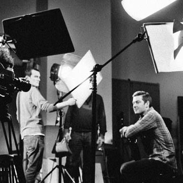 Film crew on set in black and white
