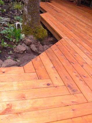 deck wrapped around landscape
