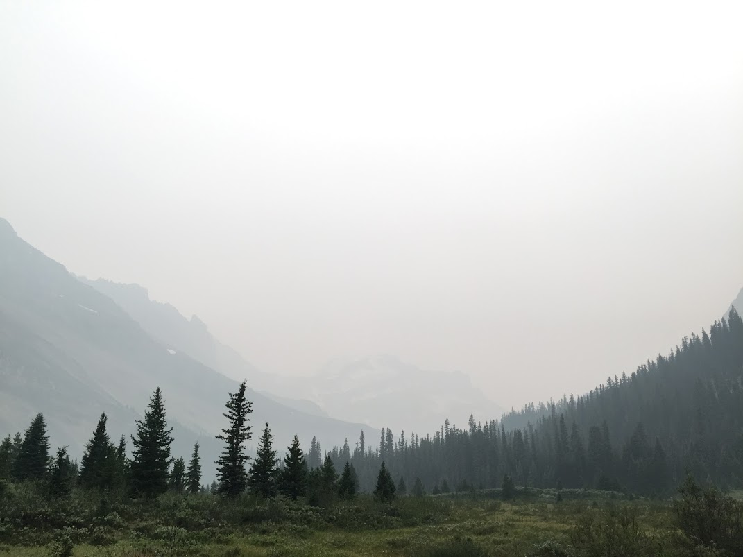 Mountains shrouded in thick smoke from a faraway forest fire.