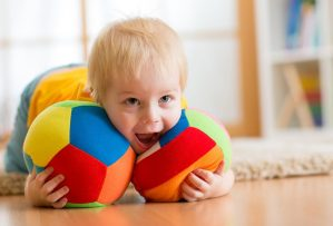 Child playing with balls