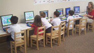 Children learning on computers