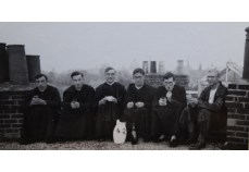 Some priests on a roof! (File reference: C42.1)