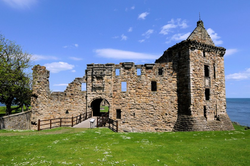 Exterior of St Andrews Castle on a sunny day and the ocean and sky in the background