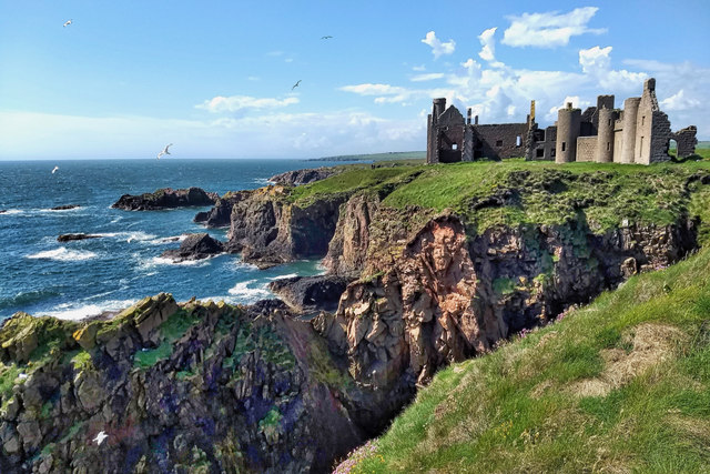 Scenic shot of New Slains Castle and waves bashing against the cliffs
