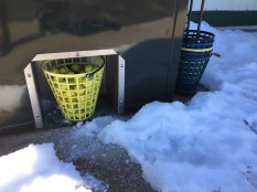 Range ball dispenser was encircled by snow this morning.