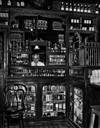 TURKEY. 1958. Pharmacist and old-fashioned pharmacy at Tepebasi. Ara Güler / Magnum Photos