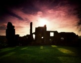 A silhouette of Monk Bretton Priory at Sunset