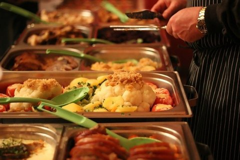 buffet with food in chafing dishes
