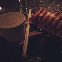 Cocktail served in paper cup with a bag of popcorn!