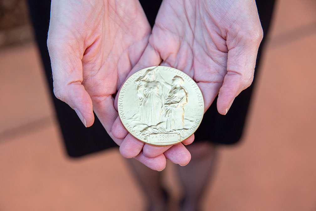Jennifer Doudna holds the Nobel Prize medal in her hands.