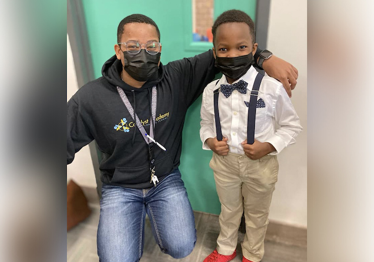 """Darren Gray, Catalyst Academy Founding Principal with a young scholar on """"Dress like the principal day"""""""
